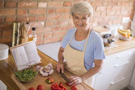 woman cooking: Diet should be full of vegetables Stock Photo