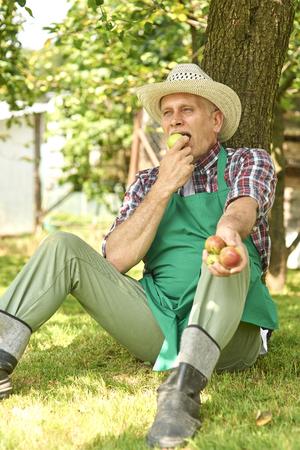 urban gardening: Adult man resting under the tree