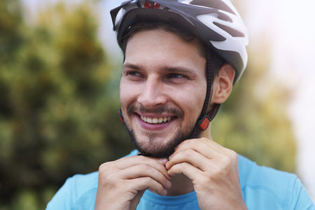 man close up: Man wearing his sports helmet