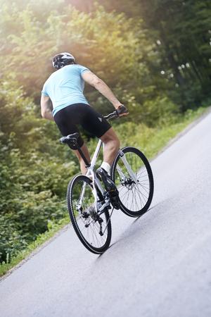 uphill: Man riding a bike uphill