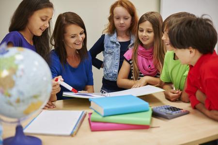 she: She always explain difficult homework Stock Photo