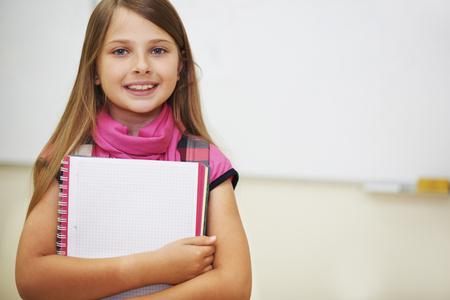dutiful: Dutiful pupil next to the whiteboard