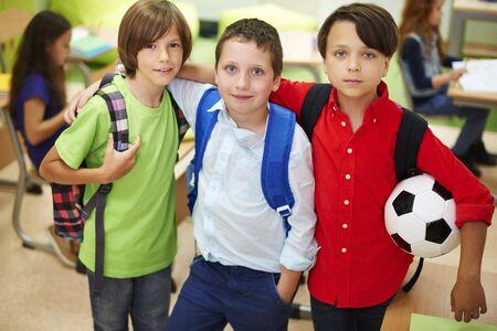elementary age boy: Boys always stick together in school