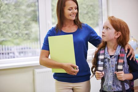 elementary student: Elementary student talking to her teacher
