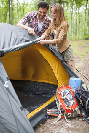 unfolding: The is the best place to unfold our tent Stock Photo