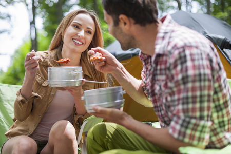 eating dinner: Couple eating dinner on camping Stock Photo