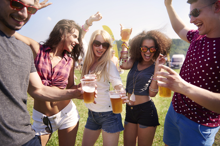 glasses of beer: Good company is most important at the party Stock Photo