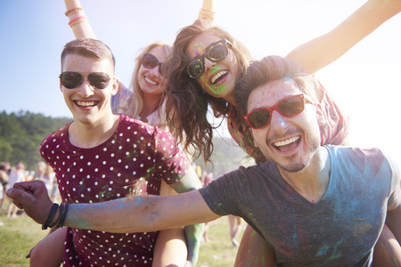 holiday music: Group of friends having fun at the festival Stock Photo