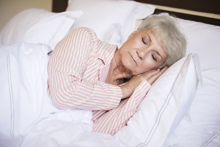 lying on side: Sweet dreams in comfortable bed Stock Photo