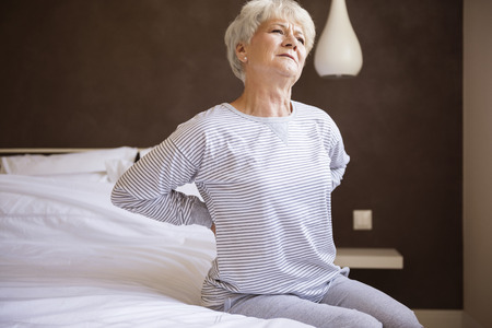 senior pain: This bed isnt comfortable for me Stock Photo