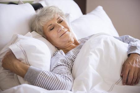 sleeping: Senior woman sleeping in the big bed