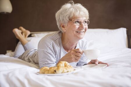 women holding cup: Start the day with delicious breakfast Stock Photo