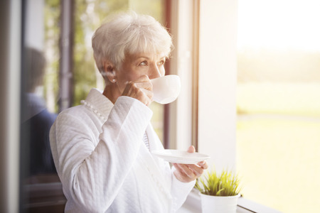 woman think: Fresh coffee tastes delicious in the morning
