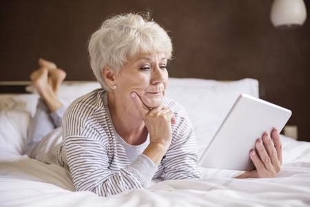 digital tablet: Bad news at the morning Stock Photo