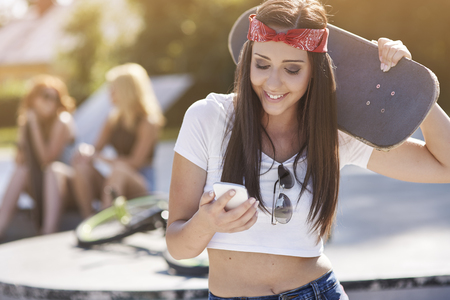 modern girl: Smartphone and skateboard are my essentials