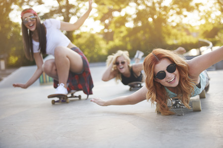 outdoor pursuit: Frenzy girls having fun in the skatepark