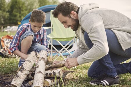 pensive: Pensive boy helping his father on camping