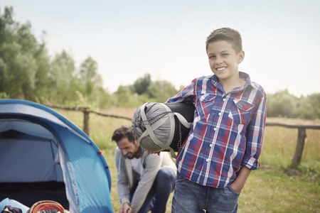 pitching: Father and son pitching a tent Stock Photo