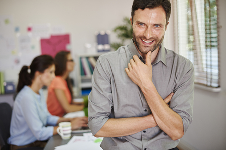 work group: He is very proud of his company and workers Stock Photo
