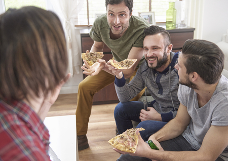 group of men: Funny conversation among four men