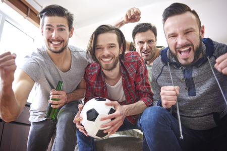 Group of best friends spending time in front of TV