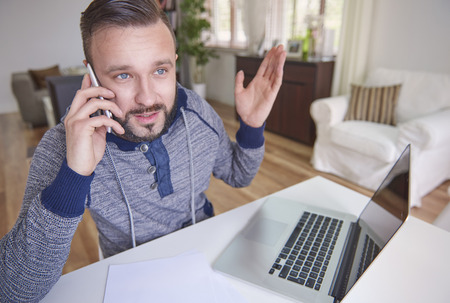 working at home: Man having problem with his laptop Stock Photo