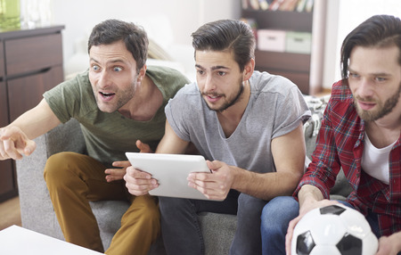 indoor soccer: Real emotions during the soccer match on TV Stock Photo