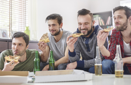 group of men: Pizza, beer and best male companion Stock Photo