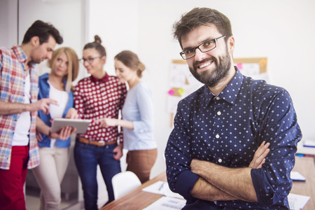 young group: He is very proud of his creative team Stock Photo