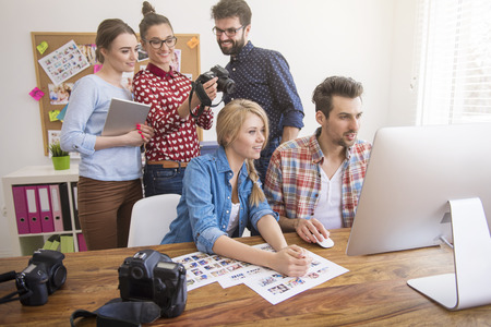 creative pictures: Busy team doing their job with passion Stock Photo