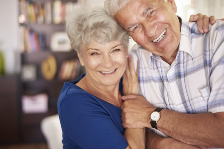 happy senior couple: Portrait of happy senior couple in arms Stock Photo