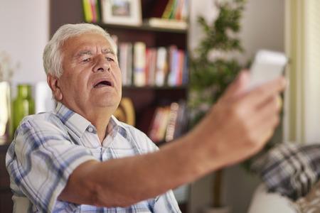 eye sight: Senior man having problem with his eye sight