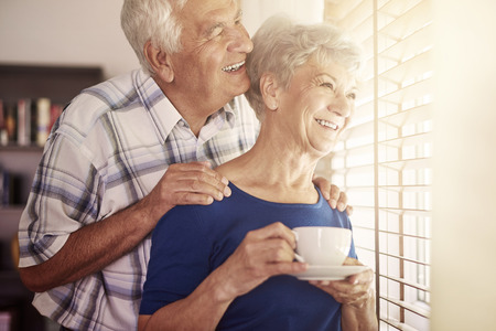 elderly: Senior couple next to the window Stock Photo