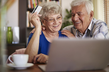 browsing the internet: Senior couple browsing Internet without any problems