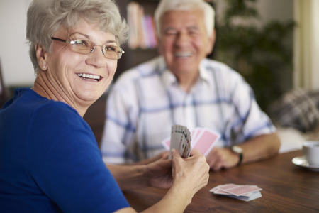 We are never too old to play cards Stock Photo