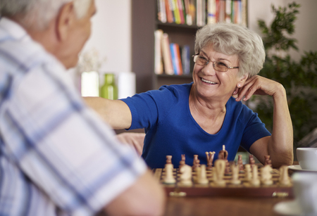playing chess: Grandmother and grandfather playing chess for relaxation Stock Photo