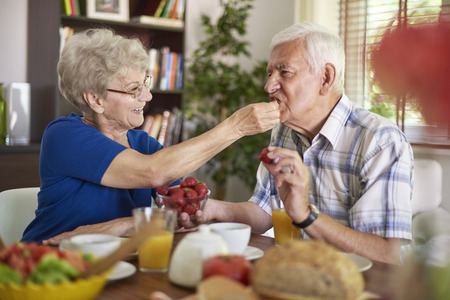 eating fruits: Seasonal strawberries are very healthy Stock Photo