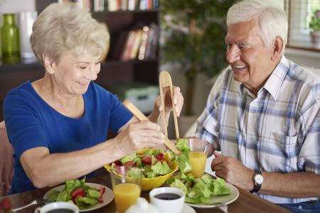 Healthy breakfast eaten by senior couple