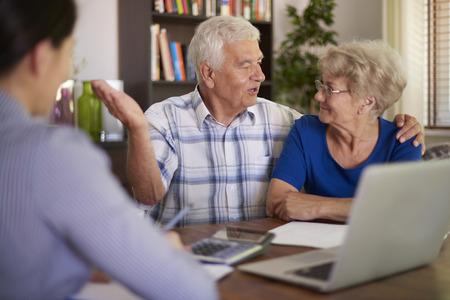 deal making: Senior couple making a financial deal