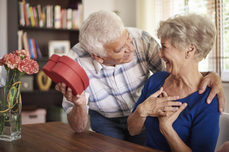 Senior husband giving a present to his wife