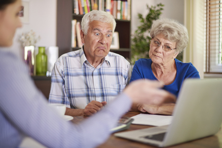 home safety: Financial counsellor giving an advice to senior couple