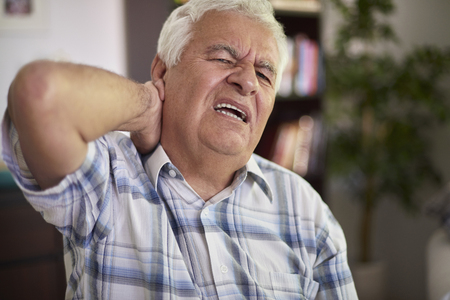 senior man on a neck pain: Neckache is a very serious problem for me Stock Photo