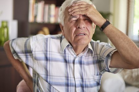 senior man on a neck pain: Getting up from the bed every day isnt easy