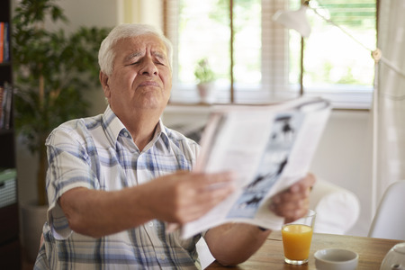 reading room: Problems with eyesight of senior man