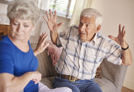 Argument between senior couple in the living room photo