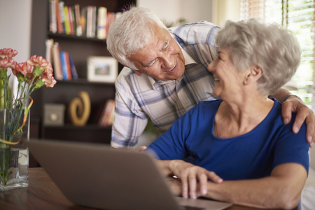 Senior marriage spending time in front of computer photo