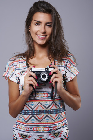 carried: Retro camera carried by charming brunette
