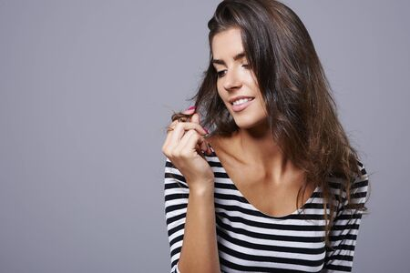 hair part: Attractive young woman playing with her hair