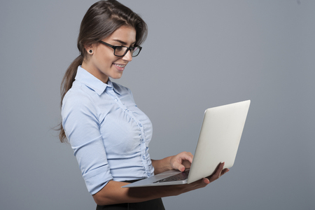 professional people: Young business woman using the laptop