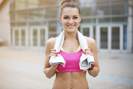 looking to camera: Woman after tiring training at the gym Stock Photo